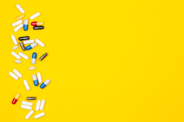 Wall Mural - Pills or drugs spilled on a colored background
