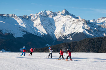 Children skiers in action on the ski slopes of Spiazzi di Gromo, Val Seriana, Lombardy, Italy