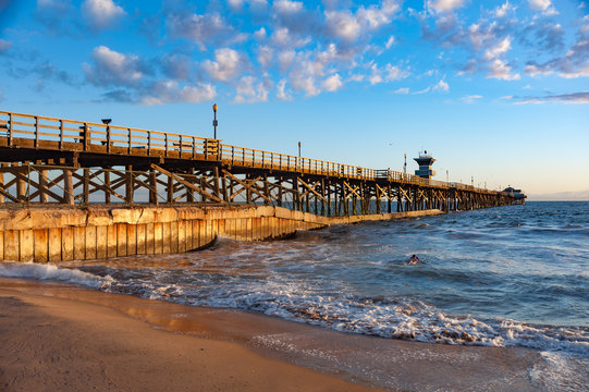 Sunset light hitting seal beach pier in  southern California