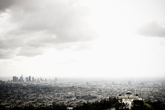 Los Angeles Skyline and Griffith Observatory Beneath Cloudy Sky