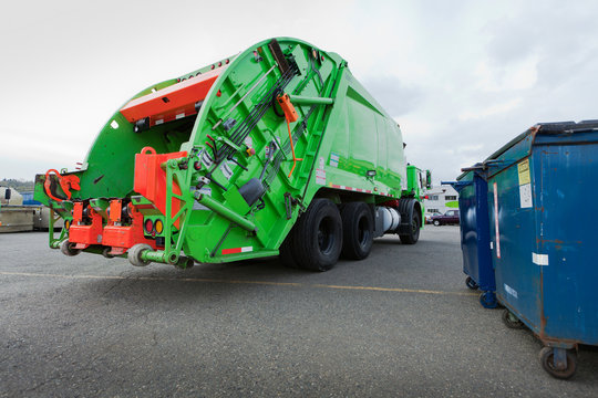 Garbage Truck Parked In A Parking Lot