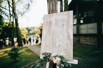 Wedding decor of handmade. Wooden board wishes