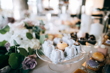Delicious wedding desserts on the table, catering service
