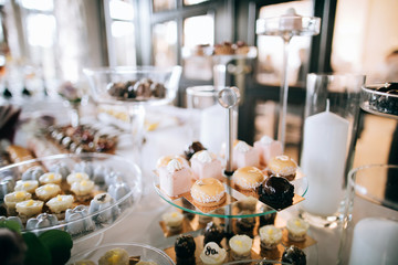 Beautiful sweets and desserts on the wedding table