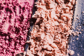 crushed blush and bronzer powders close-up shot