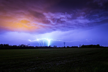 Ground to cloud GC lightning flash against a dramatic storm sky