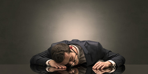 Young businessman fell asleep at his workplace with copy space
