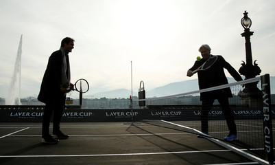 Borg of Sweden returns the ball to Switzerland's Federer during a tennis session on a temporary court on the banks of Lake Geneva in Geneva