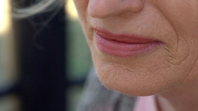 Wrinkled skin around mouth close up, plastic surgery, treatment of aging signs
