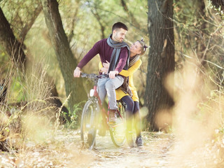 Young couple in love with bicycle in nature