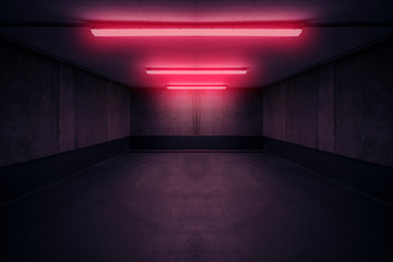 dark underground room with red neon light in basement or parking lot -