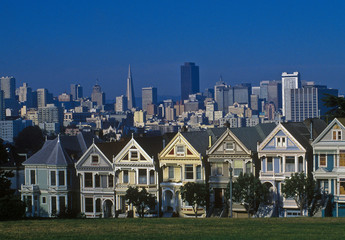 Historic houses in San Francisco and modern architecture behind.