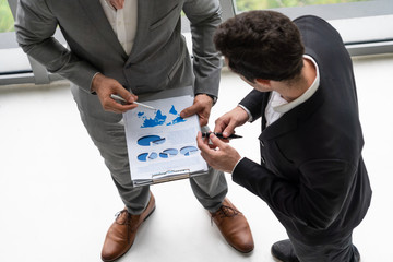 Businessman is in meeting discussion with another businessman partner in modern workplace office. People corporate business team concept.