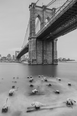 Brooklyn and manhattan bridge view from frozen pier with long exposure