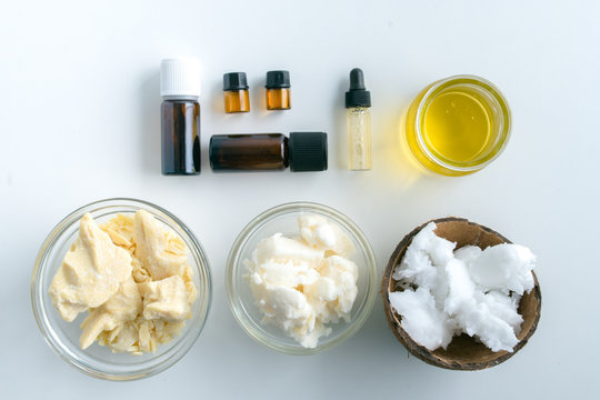 diy body butter with ingrdients on concrete background