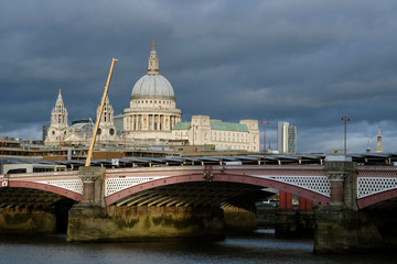 panorama with london bridge and saint paul cathedral against blue sky