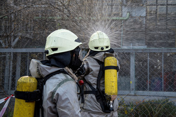 Firefighters in chemical protection suit.