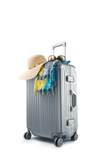 View of gray suitcase with pareo and hat on white background