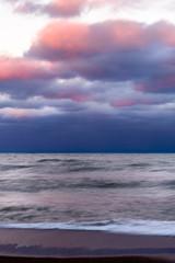 Sunset at the beach, cloudy sky