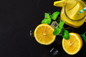 Fresh sliced lemons and peppermint leaf