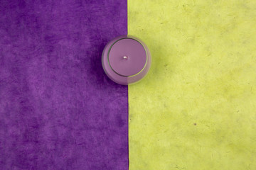 Top view of colored candles on a colorful background