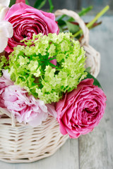 Floral arrangement with pink roses, peonies and matthiola flowers.