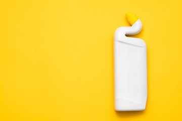 Cleaning advertising concept. White plastic bottle mockup. Copy space on yellow background.