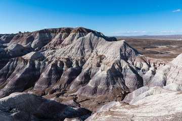 Rugged, barren, and heavily eroded desert mountain peaks in Petrified Forest National Park, Arizona