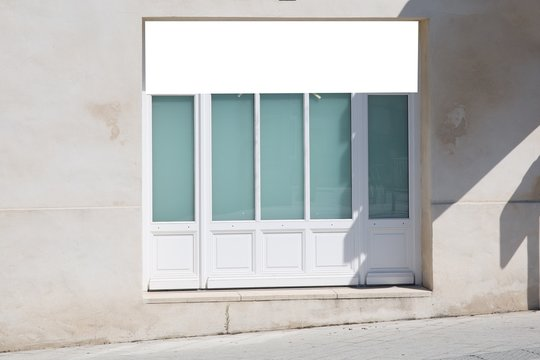 horizontal white empty blank signage on shop front with wood glass windows