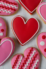 Group of Heart-shaped cookies with icing detail on white background