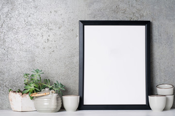 Black frame mockup with tea pot and succulent plant