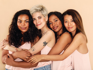 Studio shot of a group of beautiful young women hugging each other