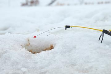 fishing pole over the hole