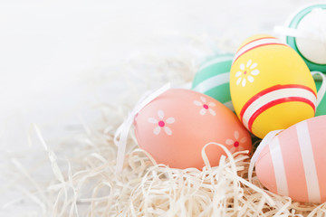 Easter Background  with Colorful painted Easter eggs. Top view, copy space.