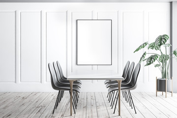 White dining room interior with poster