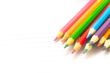 Colored pencils with light background. Back to school. School material for learning. Space for text