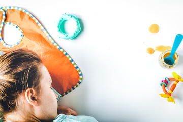 lifestyle tired mother top view on white background