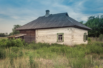 Old wooden country house with old shutters