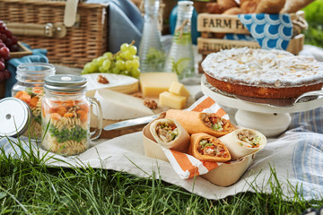 Delicious picnic food served outdoors on a rug