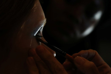 A model has her makeup done backstage for the Palm Angels collection show New York Fashion Week in New York