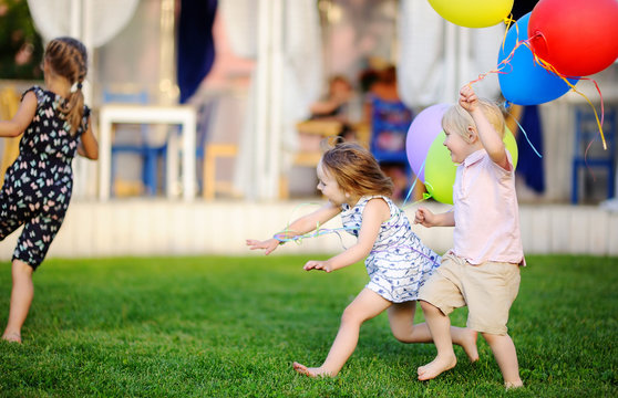 Little boy and girl having fun during celebrating birthday party