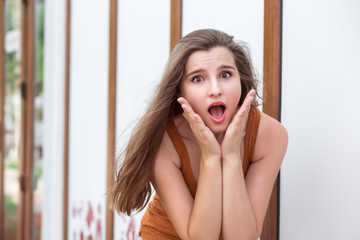 Shocked woman outdoors