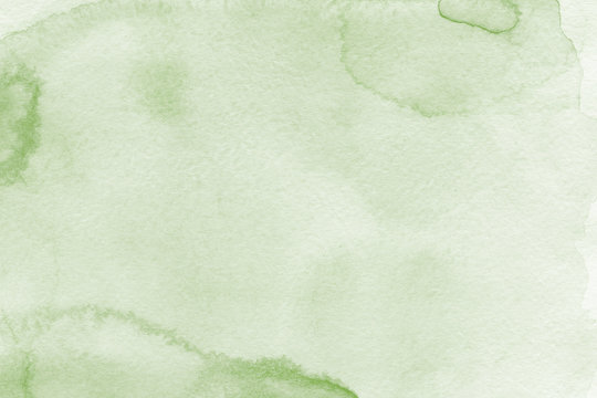 Watercolor green texture with abstract washes and brush strokes on the white paper background. Digital paper background.