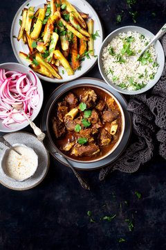 Goat Curry, Brown Rice, Baked Potato, Pickled Onion and Yogurt sauce