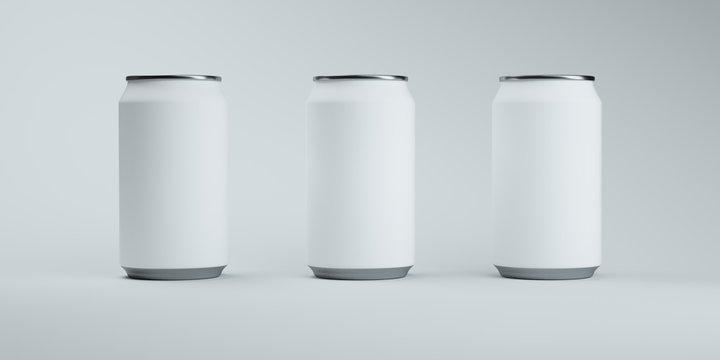 Three matte white soda cans on elegant light background