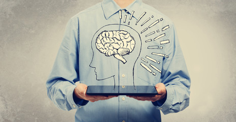 Brain illustration with young man holding a tablet computer