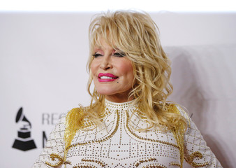Dolly Parton attends a red carpet gala event honoring her as the MusiCares person of the year in Los Angeles