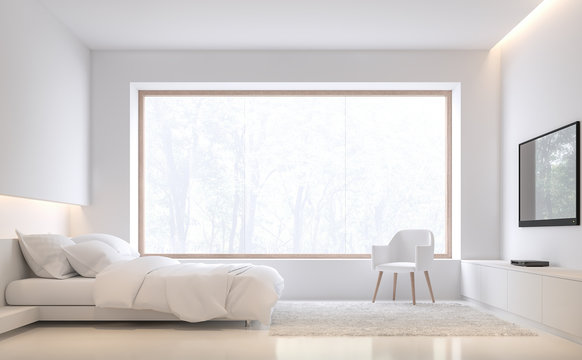 Minimal style bedroom with nature 3d render,There are white floor and wall.Furnished with white bed set.There are large wood frame window overlooks to outside.