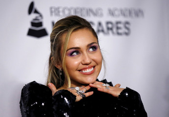 Singer Miley Cyrus attends a red carpet gala event honoring Dolly Parton as the MusiCares person of the year, ahead of the Grammy Awards, in Los Angeles