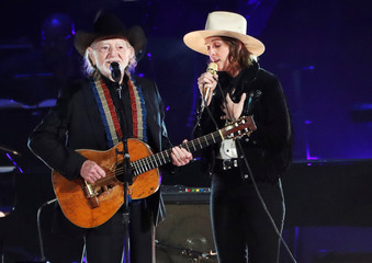 Willie Nelson and Brandi Carlile perform during a gala event honoring Dolly Parton as the MusiCares person of the year in Los Angeles